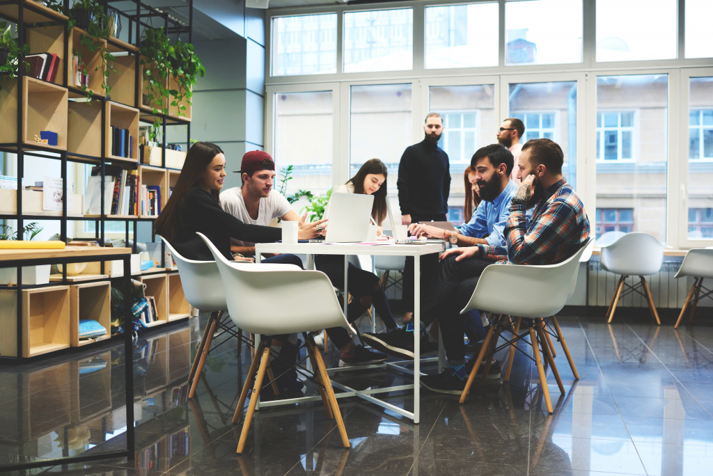 Creative professionals gathered at the meeting table for discussion