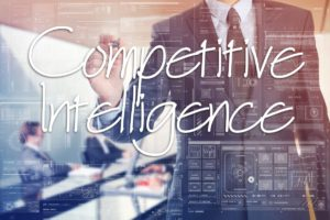 competitive intelligence written with white marker